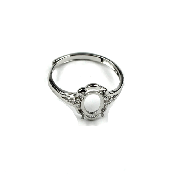 Adjustable Ring with Cubic Zirconia Inlays and Oval Prongs Mounting in Sterling Silver 5mm x 7mm